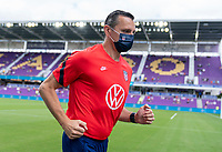 ORLANDO, FL - FEBRUARY 21: Vlatko Andonovski of the USWNT runs off the field before a game between Brazil and USWNT at Exploria Stadium on February 21, 2021 in Orlando, Florida.