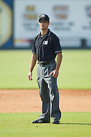 Umpire Aaron Roberts handles the calls on the bases during a South Atlantic League game between the Hagerstown Suns and the Kannapolis Intimidators at Fieldcrest Cannon Stadium August 8, 2010, in Kannapolis, North Carolina.  Photo by Brian Westerholt / Four Seam Images