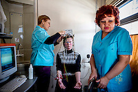 A doctor and nurse on board the Matvei Mudrov record an electroencephalogram of Nadegda Gaskevitch who struck her head in a fall in 2003 and now needs regular treatment.<br /> <br /> The Matvei Mudrov train is a medical train operated by Russian Railways along the course of the Baikal Amur Magistral (Baikal-Amur Mainline, or BAM) railway line. Named after a famous 19th century Russian physician, the train employs around 15 doctors who make about 10 trips a year, each lasting two weeks. Along the way they deliver essential medical services to people living in remote villages along the 4,324 km long BAM railway. Though not equipped to carry out surgical procedures the train has heart monitors, ultrasound and x-ray machines to deliver diagnosis.