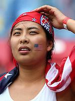 A USA fan looks on before kick off