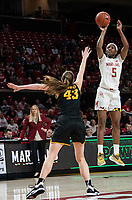 COLLEGE PARK, MD - FEBRUARY 13: Kaila Charles #5 of Maryland guides a shot over Amanda Ollinger #43 of Iowa during a game between Iowa and Maryland at Xfinity Center on February 13, 2020 in College Park, Maryland.