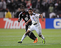 Los Angeles Galaxy forward Miguel Lopez (25) shields the ball against DC United midfielder Clyde Simms (19).  DC United tied Los Angeles Galaxy 1-1, at RFK Stadium, Saturday April 9, 2011.