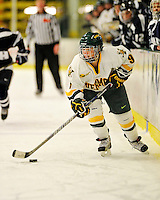 11 February 2011: University of Vermont Catamount defender Danielle Rancourt, a Freshman from Sudbury, Ontario, in action against the University of New Hampshire Wildcats at Gutterson Fieldhouse in Burlington, Vermont. The Lady Catamounts defeated the visiting Lady Wildcats 4-2 in Hockey East play. Mandatory Credit: Ed Wolfstein Photo