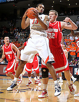 Dec. 07, 2010; Charlottesville, VA, USA;  Virginia Cavaliers forward Mike Scott (23) grabs the rebound in front of Radford Highlanders center Martins Abele (32) during the game at the John Paul Jones Arena. Virginia won 54-44. Mandatory Credit: Andrew Shurtleff