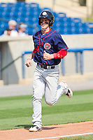 Bryce Harper #34 of the Hagerstown Suns scores a run against the Rome Braves at State Mutual Stadium on May 2, 2011 in Rome, Georgia.   Photo by Brian Westerholt / Four Seam Images