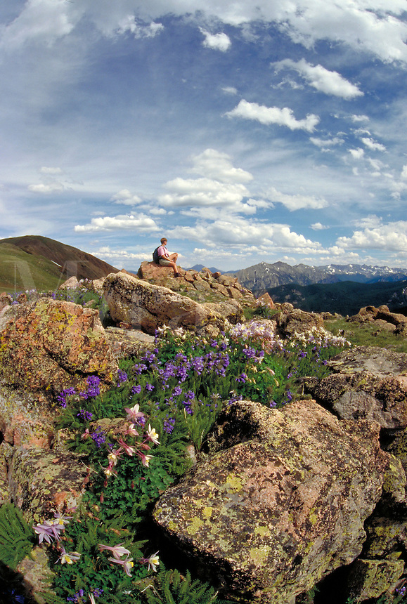 Woman resting while hiking in the scenic backcountry of Arapaho National Forest, Colorado.