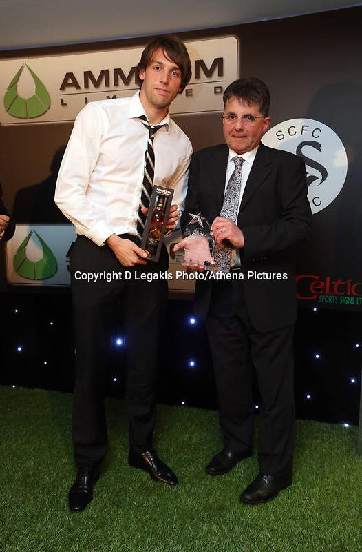 Thursday 16 May 2013<br /> Pictured: Michu (L) presented with award by Hugo Valerio<br /> Re: Swansea City FC footballer of the year awards dinner at the Liberty Stadium.