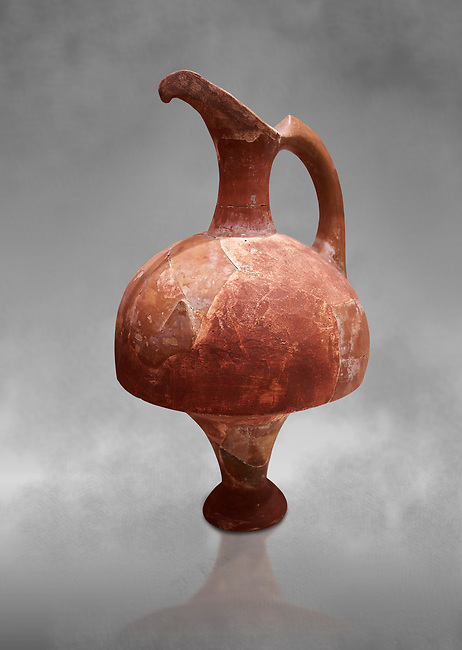 Hittite terra cotta red glazed beak spout pitcher . Hittite Period, 1600 - 1200 BC.  Hattusa Boğazkale. Çorum Archaeological Museum, Corum, Turkey. Against a grey bacground.