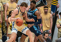 WASHINGTON, DC - FEBRUARY 8: Chase Paar #3 of George Washington clashes with Cyril Langevine #10 of Rhode Island during a game between Rhode Island and George Washington at Charles E Smith Center on February 8, 2020 in Washington, DC.