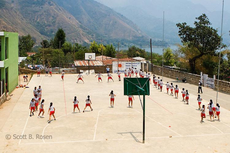 Grade school girls exercise during gym class in San Juan La Laguana, Lake Atitlan, Guatemala