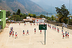 Grade school girls exercise during gym class in San Juan La Laguana, Lake Atitlan, Guatemala