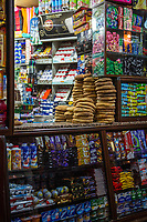 Marrakesh, Morocco.  Neighborhood Sundries Shop with Bread for Sale in the Medina.
