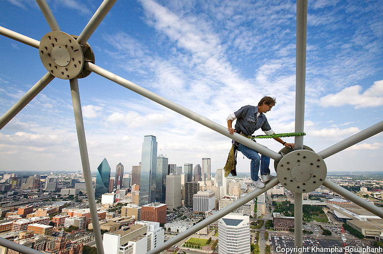 A Hyatt Regency Hotel employee climbs on top of Reunion Tower overlooking the the downtown Dallas skyline on September 18, 2008.  (photo by Khampha Bouaphanh)