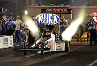 Apr 7, 2006; Las Vegas, NV, USA; NHRA Top Fuel driver Melanie Troxel in the Skull Gear/Torco Race Fuels dragster during qualifying for the Summitracing.com Nationals at Las Vegas Motor Speedway in Las Vegas, NV. Mandatory Credit: Mark J. Rebilas
