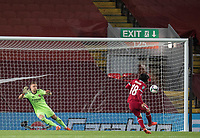 1st October 2020; Anfield, Liverpool, Merseyside, England; English Football League Cup, Carabao Cup, Liverpool versus Arsenal; Takumi Minamino of Liverpool sends Arsenal goalkeeper Bernd Leno the wrong way during the penalty shootout