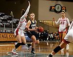 SIOUX FALLS, SD - MARCH 6: Keni Jo Lippe #33 of the Oral Roberts Golden Eagles tries to drive past Liv Korngable #2 of the South Dakota Coyotes during the Summit League Basketball Tournament at the Sanford Pentagon in Sioux Falls, SD. (Photo by Dave Eggen/Inertia)