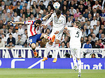 Real Madrid's Raphael Varane (c) and Fabio Coentrao (r) and Atletico de Madrid's Arda Turan during Champions League 2014/2015 Quarter-finals 2nd leg match.April 22,2015. (ALTERPHOTOS/Acero)