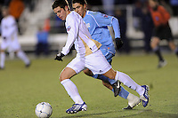 Akron Zips Ben Speas (17) is chased by North Carolina Tar Heals Michael Farfan (19). The Akron Zips defeated the North Carolina Tar Heals 5-4 in penalty kicks after playing a scoreless game during the second semi-final match of the 2009 NCAA Men's College Cup at WakeMed Soccer Park in Cary, NC on December 11, 2009.