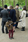 Combined Cavalry Old Comrades Association and parade Hyde Park London UK. Like father like son. A child uses his fathers umbrella as a pretend gun.Playing with guns. 2012