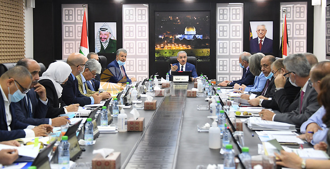 Palestinian Prime Minister Mohammed Ishtayeh chairs the weekly meeting of his government, in the West Bank city of Ramallah on August 10, 2021. Photo by Prime Minister Office