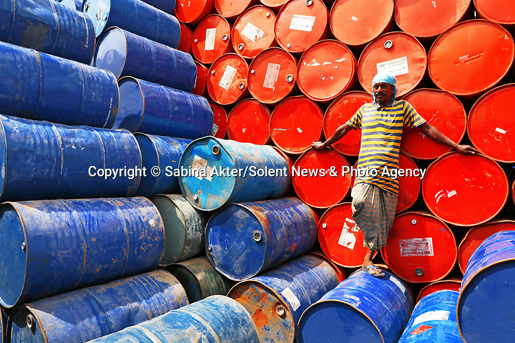 Colourful oil drums are stacked in rows by workers.  About 1,000 empty barrels are sorted and piled up after being sent by factories which have used them.<br /> <br /> Amateur photographer Sabina Akter captured the shots of the drums - which can hold about 200 litres of oil - in Narayanganj, Bangladesh.  SEE OUR COPY FOR DETAILS.<br /> <br /> Please byline: Sabina Akter/Solent News<br /> <br /> © Sabina Akter/Solent News & Photo Agency<br /> UK +44 (0) 2380 458800