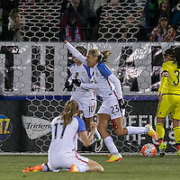 East Hartford, Connecticut - April 6, 2016: International friendly. U.S. Women's National Team (USWNT) (white) vs Colombia (yellow), n-n, at Pratt and Whitney Stadium on Rentschler Field. First half action, 4-0.