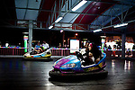 """A young couple  in their bumper car in Basraland a recently opened amusement park in the southern Iraqi city of Basra. .From """"Yesterday's War, Today's Iraq,"""" an ongoing series documenting Iraq and Iraqis as US forces withdraw from the country and media interest wanes. ."""