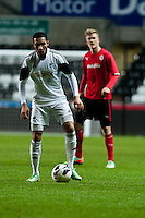 Monday 20 January 2014<br /> Pictured: Kenji Gorre ( with ball ) makes his way through the Caediff defence<br /> Re: Swansea City U21 v Cardiff City U21 at the Liberty Stadium, Swansea Wales