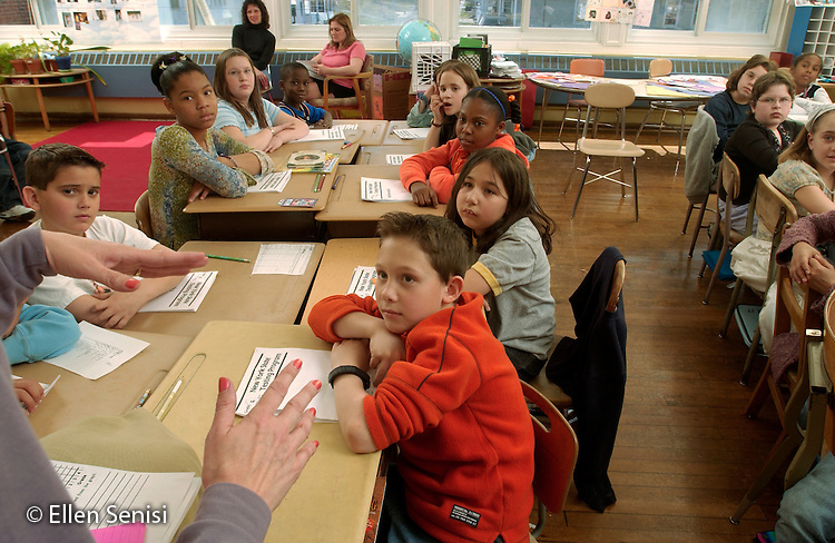 MR / Schenectady, NY.Yates Arts-in-Education Magnet School (urban elementary school) .Grade 4.Teacher talks to students about upcoming Elementary-Level State Assessments for Grade 4; practice booklets for the math test are on students' desks. Teacher stresses importance of working hard as well as attempts to reduce anxiety over their first major testing hurdle, as 4th grade is the first year students take NYS standardized tests and will take Elementary-Level State Assessments for Grade 4 Mathematics, English Language Arts, and Science. (In early fifth grade, they will also be tested on social studies material learned in fourth grade.).MR:  g4m   Mon12.©Ellen B. Senisi