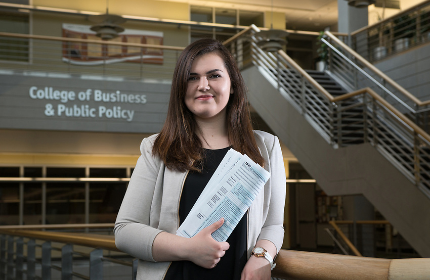Accounting Club President Yelena Sinyawski, photographed outside the College of Business & Public Policy in UAA's Rasmuson Hall. Sinyawksi, who is double majoring in Accounting and Management, has a strong interest in foresnic accounting and recently participated in the IRS's Adrian Project. The Adrian Project offers college students the opportunity to participate in a simulated financial criminal investigation run by IRS special agents.