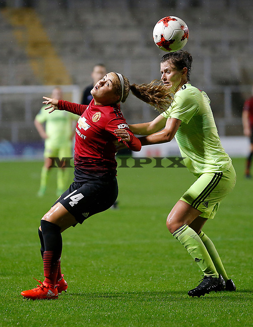 Charlie Devlin of Manchester United Women and Danielle Cox of Sheffield Utd Women