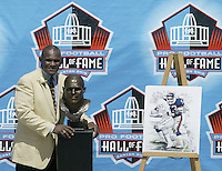 Harry Carson, former New York Giant, poses with his bust during the Pro Football Hall of Fame induction ceremony Saturday, Aug. 5, 2006, in Canton, Ohio.<br />
