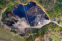 A pond contaminted with pollution, debris and garbage, next to traditional agricultural land. /Felix Features