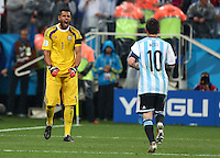 Argentina goalkeeper Sergio Romero celebrates Lionel Messi scoring his penalty during the shootout