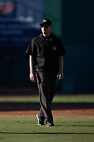 Umpire Sean Cassidy handles the calls on the bases during the game between the Hudson Valley Renegades and the Greensboro Grasshoppers at First National Bank Field on September 2, 2021 in Greensboro, North Carolina. (Brian Westerholt/Four Seam Images)