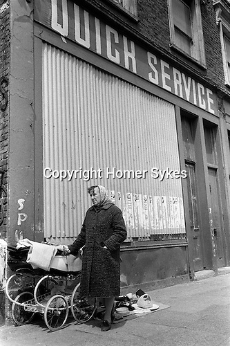 Woman selling second hand clothes Whitechapel, east London England. 1972.
