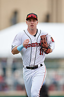 Rochester Red Wings left fielder Brent Rooker (19) jogs to the dugout during an International League game against the Charlotte Knights on June 16, 2019 at Frontier Field in Rochester, New York.  Rochester defeated Charlotte 3-2 in the second game of a doubleheader.  (Mike Janes/Four Seam Images)