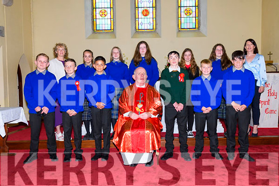 The group of children who received their Confirmation at the Church of the Sacred Heart in Annascaul on Wednesday evening. Front left: Francis Ó Brien, Fionn Spillane, Devden Mukherjee, Sean Casey, Jack Lyne, Eoin MCCarthy, and, back left: Helenka Murphy, Aoife Nwestead, Megan Brosnan, Stephanie Reid, Mollie Greaney, here pictured with muinteoir Clar Uí Mhurchadha, principal Mary Murphy and fr. Michael Moynihan.