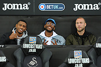 Luciano Narsingh (left) Leroy Fer (centre) and Mike van der Hoorn (right) of Swansea City during the Carabao Cup Second Round match between Swansea City and Crystal Palace at Liberty Stadium, in Swansea, Wales. August 28, 2018