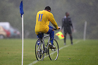 A Clapton Rangers FC player is seen leaving a Hackney & Leyton Sunday League game at Hackney Marshes on a bicycle as the rain falls - 05/10/08 - MANDATORY CREDIT: Gavin Ellis/TGSPHOTO - Self billing applies where appropriate - Tel: 0845 094 6026
