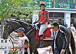 Flat Out (no. 1), ridden by Rosie Napravnik and trained by William Mott, before the grade 2 Monmouth Cup Stakes for three year olds and upward on July 07, 2012 at Monmouth Park in Oceanport, New Jersey.  (Bob Mayberger/Eclipse Sportswire)