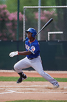 Texas Rangers Chad Smith (12) during an instructional league game against the Seattle Mariners on October 5, 2015 at the Surprise Stadium Training Complex in Surprise, Arizona.  (Mike Janes/Four Seam Images)