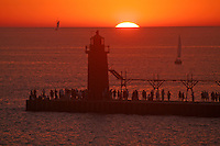 Sunset beach people lighthouse at South Haven Michigan