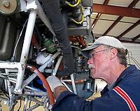 Aeroventure aicraft mechanic Joe Davis does an oil change, Petaluma Municipal Airport, Petaluma, Sonoma County, California