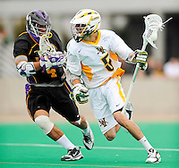 10 April 2011: University of Vermont Catamount midfielder Kodie Englehart, a Freshman from Coronado, CA, in action against the University at Albany Great Danes on Moulton Winder Field in Burlington, Vermont. The Catamounts defeated the visiting Danes 11-6 in America East play. Mandatory Credit: Ed Wolfstein Photo