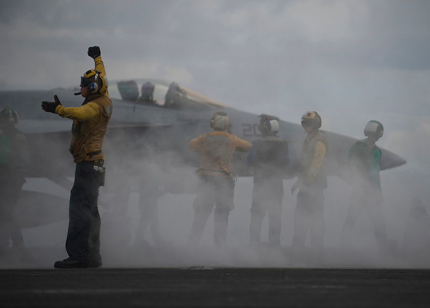 120416-N-DR144-568 INDIAN OCEAN (April 16, 2012)  An aircraft director guides an F/A-18 Hornet onto the bow catapults for launch on the flight deck of the Nimitz-class aircraft carrier USS Carl Vinson (CVN 70). Carl Vinson and Carrier Air Wing (CVW) 17 are deployed participating in the Malabar Exercise with ships and aircraft from the Indian Navy. (U.S. Navy photo by Mass Communication Specialist 2nd Class James R. Evans/Released)