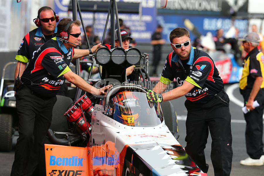 Feb 20, 2015; Chandler, AZ, USA; Crew members with NHRA top fuel driver Clay Millican in the staging lanes during qualifying for the Carquest Nationals at Wild Horse Pass Motorsports Park. Mandatory Credit: Mark J. Rebilas-