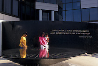 AJ4009, Civil Rights Memorial, Montgomery, Alabama, Two black women with a baby read the inscriptions on the Civil Rights Memorial in Montgomery in the state of Alabama.