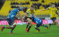 Hurricanes' Jordie Barrett is tackled during the Super Rugby Aotearoa match between the Hurricanes and Blues at Sky Stadium in Wellington, New Zealand on Saturday, 18 July 2020. Photo: Dave Lintott / lintottphoto.co.nz