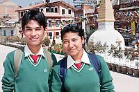 Bodhnath, Nepal.   Nepalese Students from the Newari Ethnic Group at the Buddhist Stupa of Bodhnath.